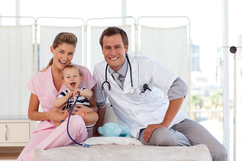 Download Doctors Taking Care Of A Young Child Royalty Free Stock Photo - Image: 9138075
