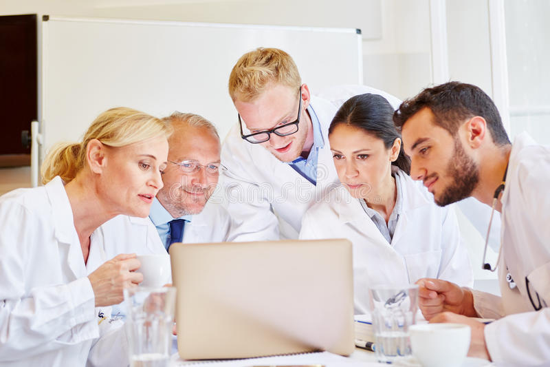 Doctors in videoconference with colleagues royalty free stock photos