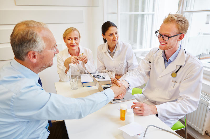 Doctors welcome patient to consultation royalty free stock photos