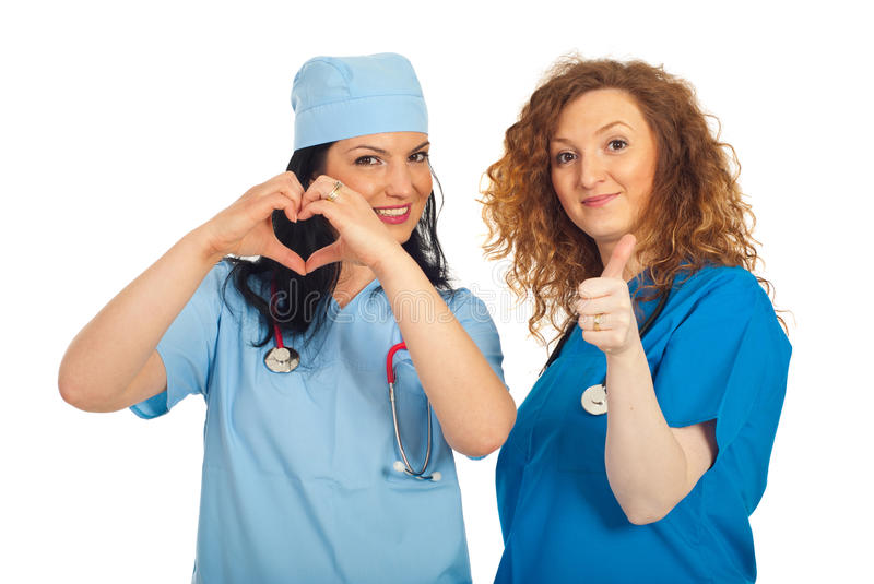 Download Doctors Women With Heart Shape And Thumbs Stock Photo - Image: 19477488