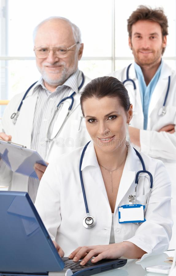 Doctors working at desk stock photography