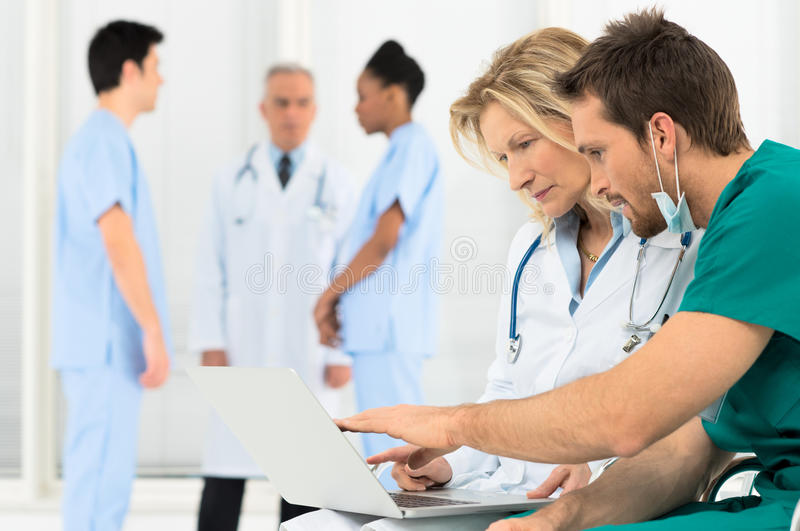 Doctors Working On Laptop royalty free stock photos