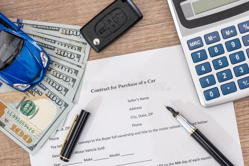 Documant, dollar, pen, calculator and toy car. With keys stock image