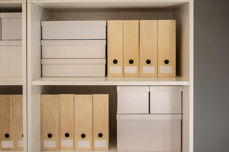 Archive folders on wooden shelves. stock photos