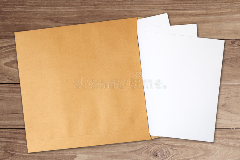 Document in brown develop. White paper document in brown develop on wooden background stock image