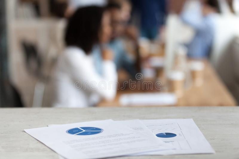 Document with financial report, pie diagram on office table. Document with financial report, pie diagram, marketing plan, paper business document on office table royalty free stock photo