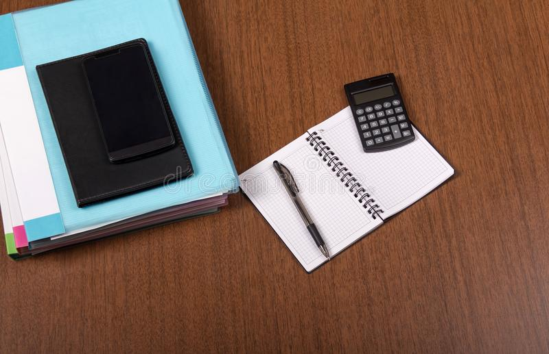 Document folders, diary and calculator on the table stock photography