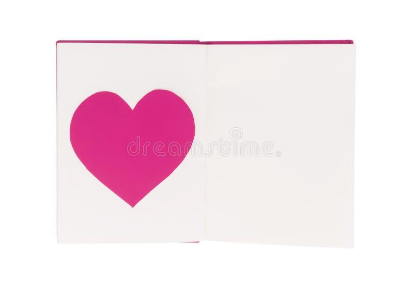 Document hart op leeg open boek dat op wit wordt geïsoleerd stock foto's