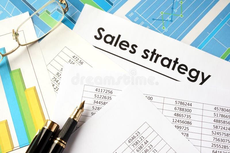 Document met de strategie van de titelverkoop stock afbeelding