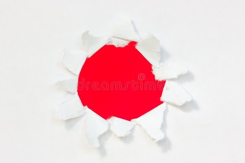 Document met rood binnen gat stock fotografie