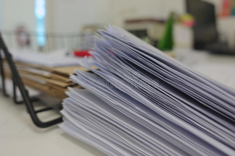 Document pile on office desk royalty free stock photo