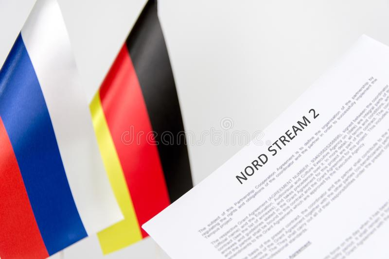 Russia germany flag nord stream. Document project russia germany flag nord stream 2 blurred background stock images