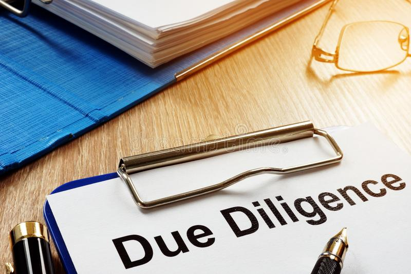 Document with title Due Diligence. Document with title Due Diligence on a desk royalty free stock image