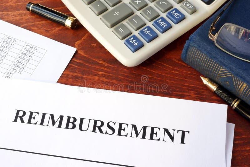 Document with title reimbursement. Document with title reimbursement on a table royalty free stock image