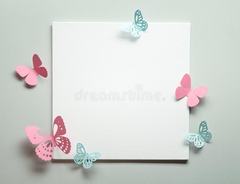 Document vlinder op papier royalty-vrije stock afbeelding