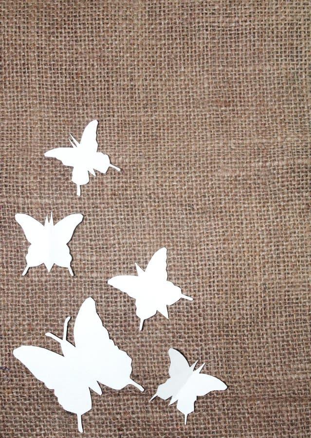 Document vlinders met jutedoek stock foto