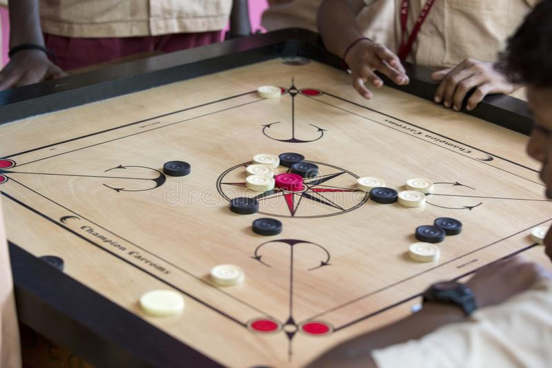 Carrom Board With Striker And Coins Stock Photo - Image of ...