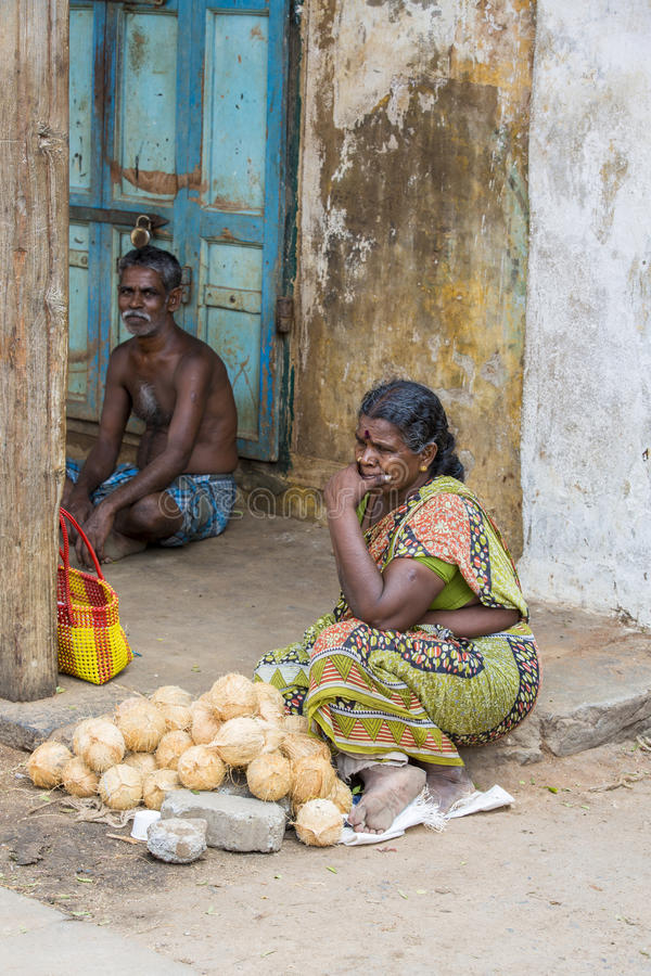 Documentary editorial image,Poverty in the street India. Documentary editorial image. Pondicherry, Tamil Nadu, India - May 28 2014. Very poor man and woman royalty free stock photography