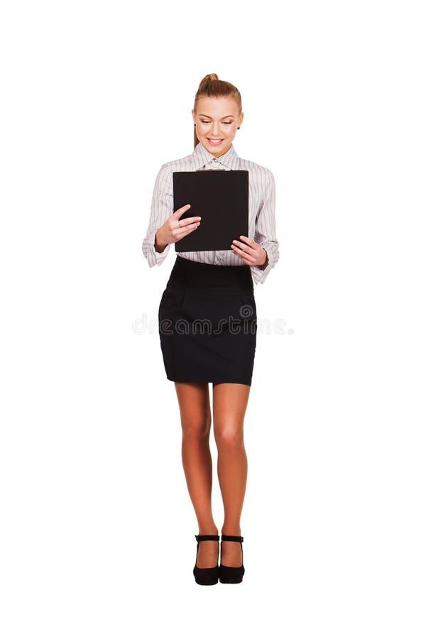 Documenti della tenuta della donna di affari per la firma fotografie stock