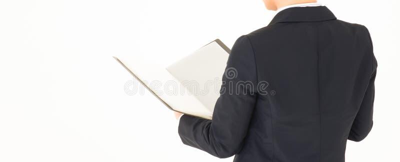 Documento abierto del hombre de negocios Visi?n posterior Cosecha para la bandera foto de archivo libre de regalías