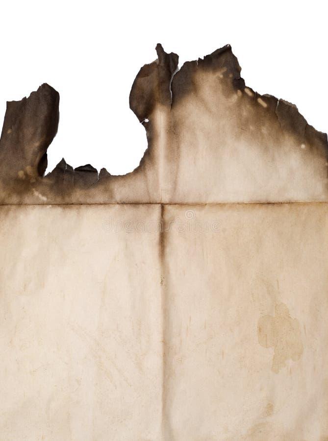 Documento bruciato su bianco immagine stock
