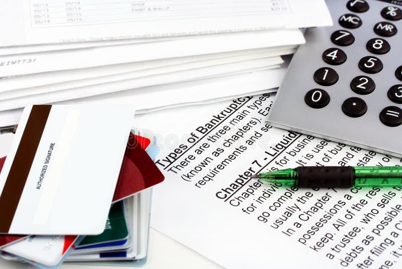 Documento de la bancarrota con las cuentas fotos de archivo libres de regalías