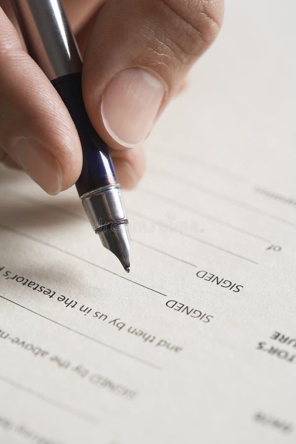 Documento di firma della mano fotografia stock