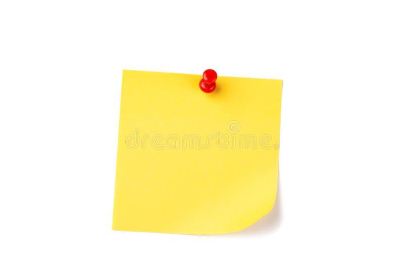 Documento di nota giallo con il perno rosso fotografia stock libera da diritti