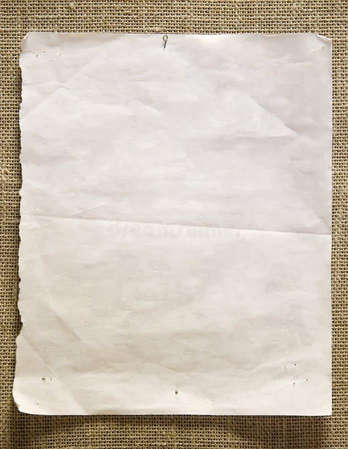 Documento di Pin su una parete fotografie stock
