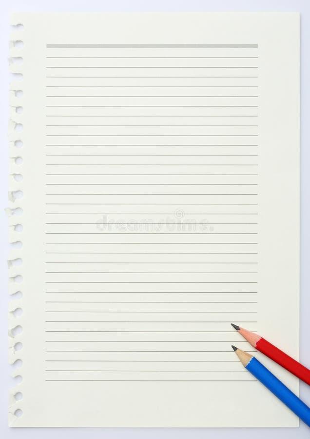 Documento e matite fotografie stock