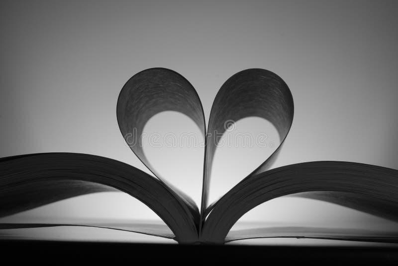 Documento a forma di del cuore immagini stock