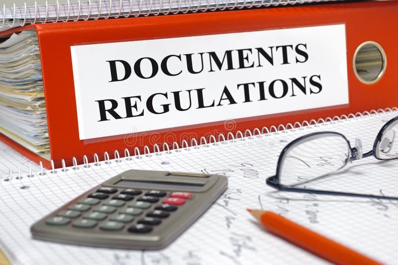 Documentos y regulaciones foto de archivo