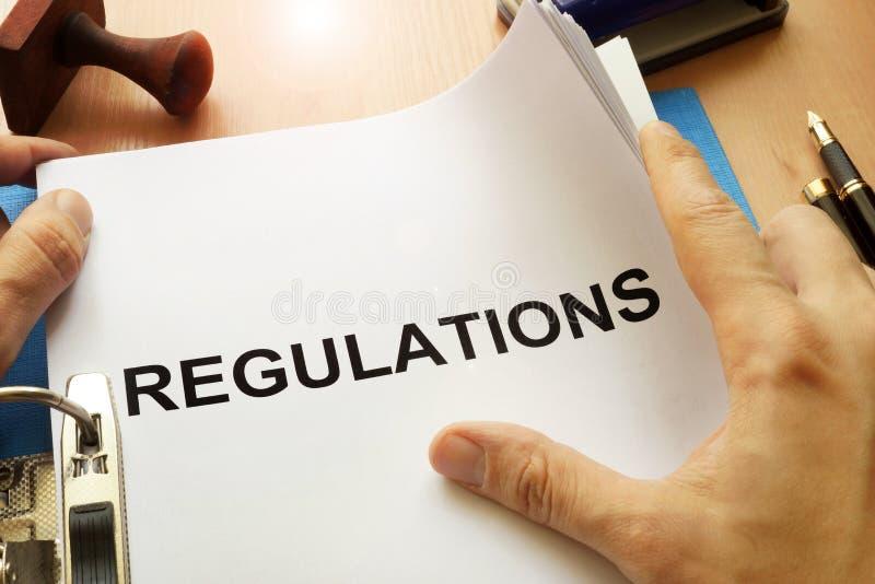 Documents avec des règlements de titre images libres de droits