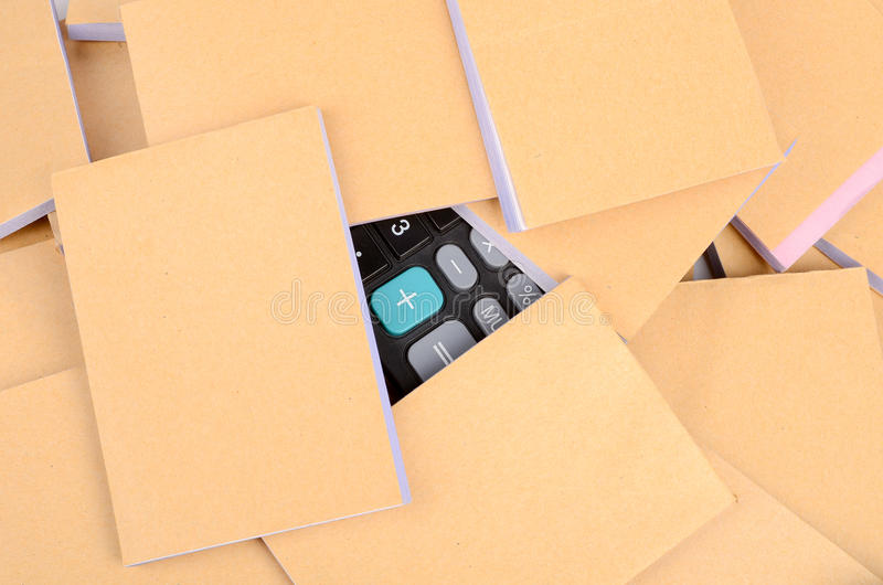 Documents and calculator. On white background royalty free stock image