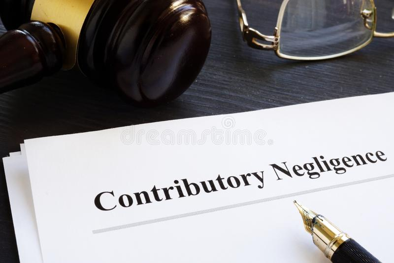 Documents about contributory negligence in a court. Documents about contributory negligence in the court stock photo
