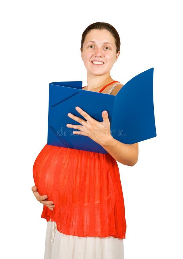 documents den lyckliga gravida avläsningskvinnan royaltyfria foton