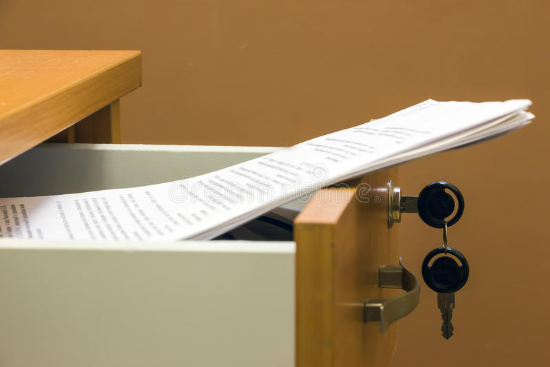 Documents in a desk drawer stock photography
