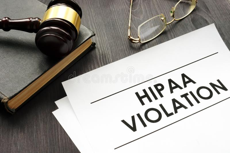 Documents about HIPAA violation and gavel in the court stock photography