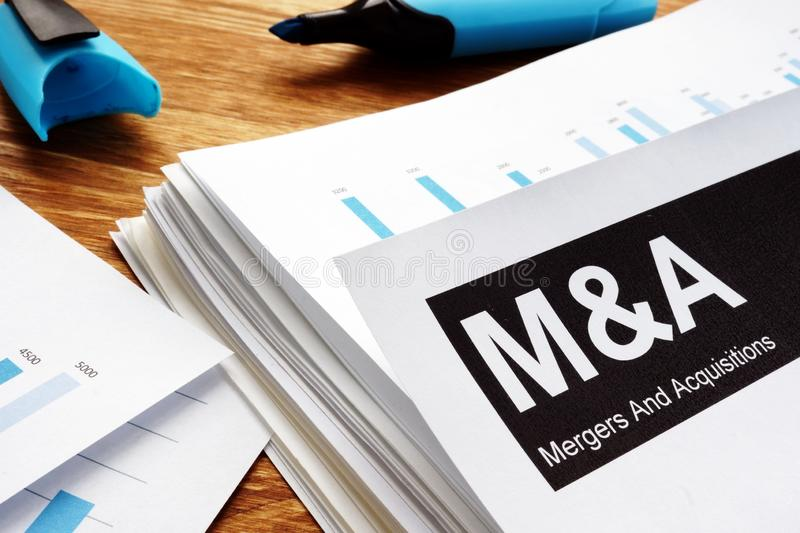 Documents about mergers and acquisitions m&a. stock photo
