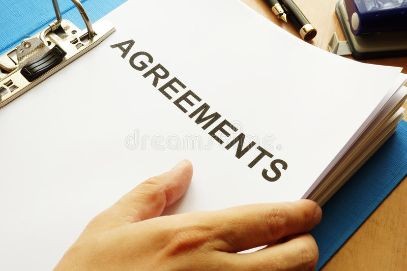 Documents with title Agreements. Documents with title Agreements on a table stock image
