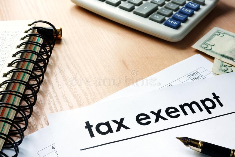 Documents with title tax exempt on a table. Documents with title tax exempt on an office table royalty free stock photos