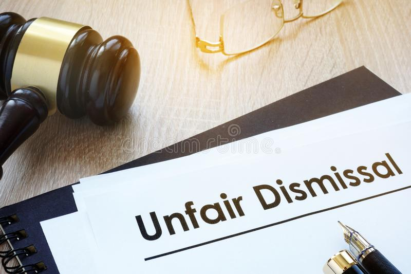 Documents unfair dismissal in a court. Documents unfair dismissal and gavel in a court stock image