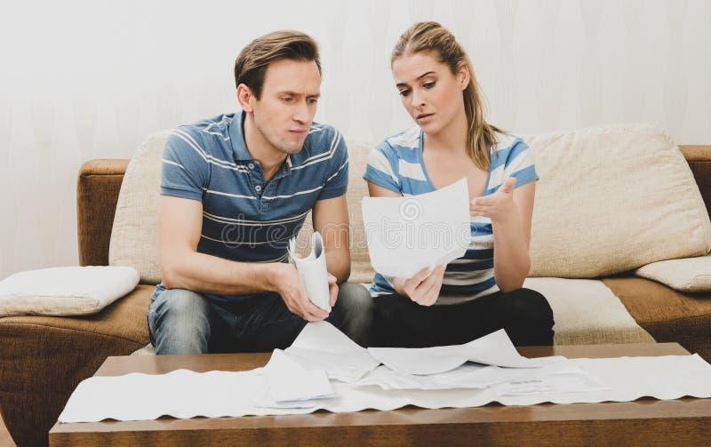 Documents worried couple stock photo