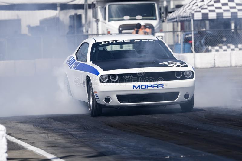 Dodge challenger on the race track. Front view of dodge challenger making a smoke show on the track during the nhra national open July 13-15 2019 stock photos