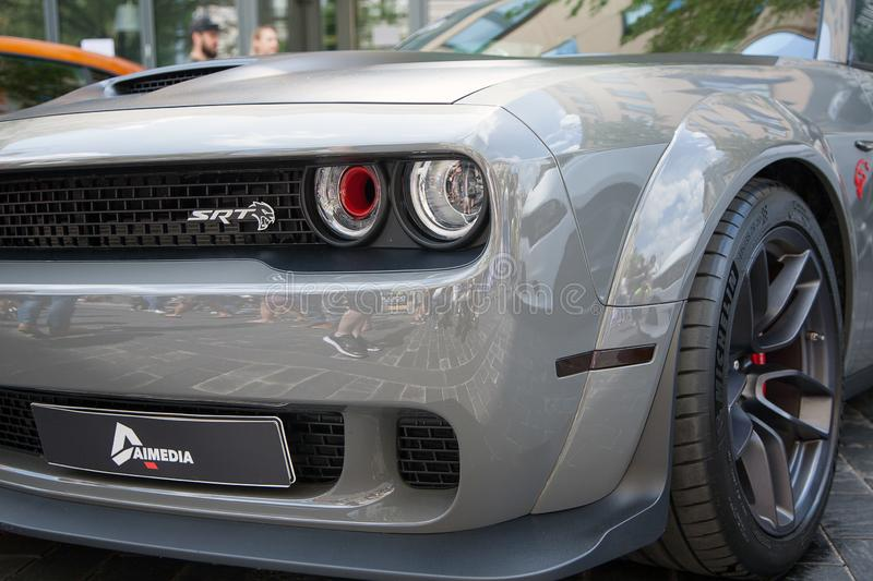 Dodge challenger SRT gray paint. Dodge challenger SRT in Memel motor fest 2019 in Vilnius. Car with gray paint. Visible head lights and front rim with bumper stock photos