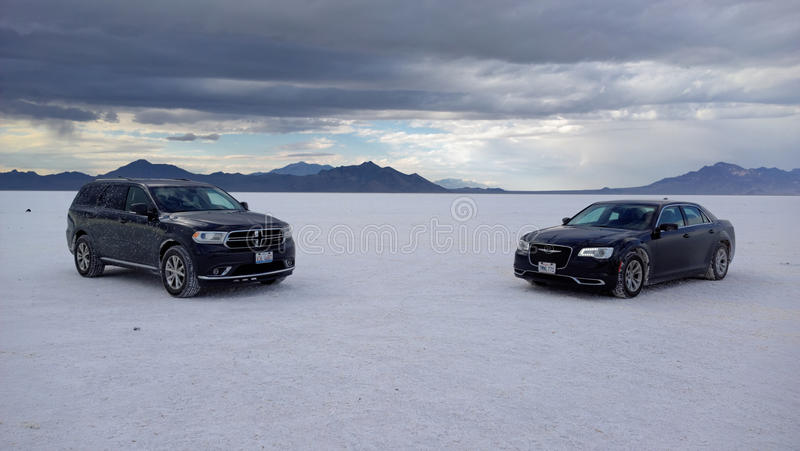 Dodge Durango and Chrysler 300 on Salt Lake (Bonneville) royalty free stock photos