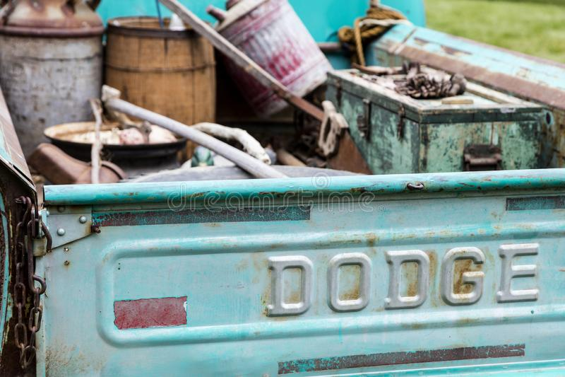 Dodge pickup truck tailgate old weathered junk faded stock photos