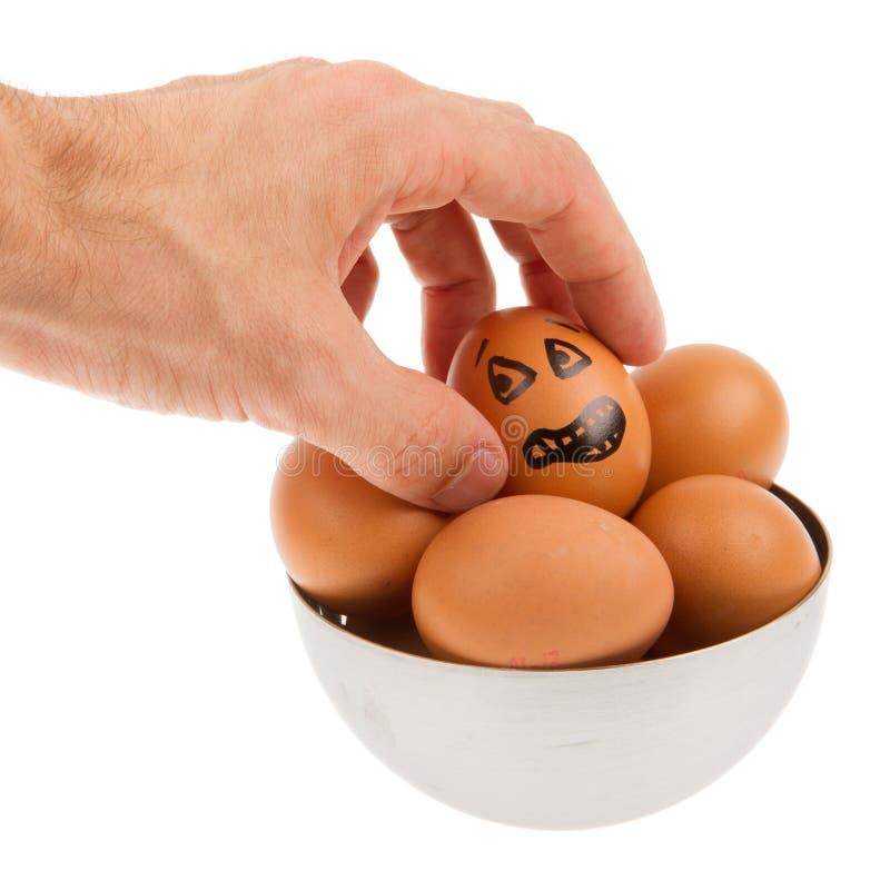 Doen schrikken ei, die door een hand wachten worden gegrepen royalty-vrije stock foto's