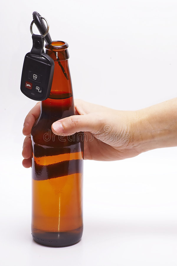Doens't Mix series. Hand holding alcoholic baverage with car key royalty free stock images
