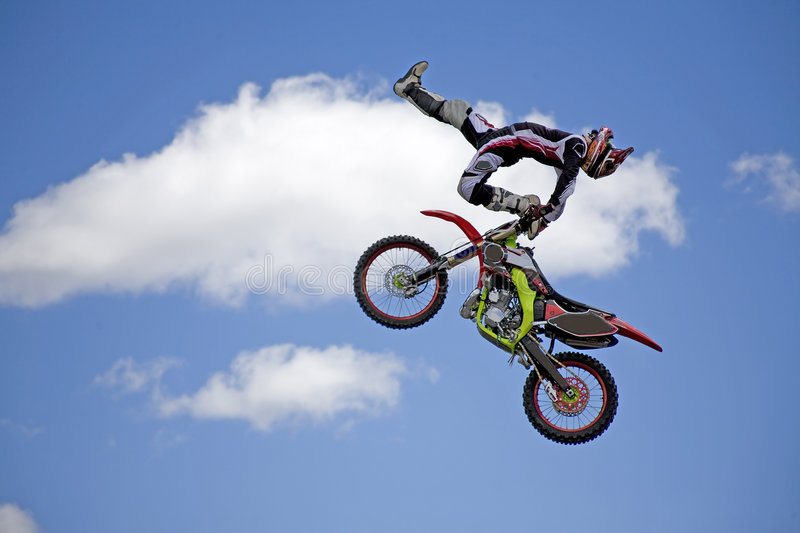 Does this look good enough. Moto cross stunt man putting on a show at elliot lake drag races royalty free stock photo